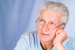 Old guy on blue Stock Photography