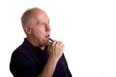 Old Guy Brushing His Teeth Royalty Free Stock Photos