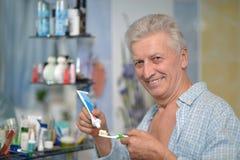 Old guy brushing teeth Royalty Free Stock Image