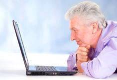 Old guy with computer Royalty Free Stock Image