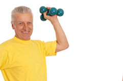 Old guy with dumb bells. Pretty old man with dumb bells on white Royalty Free Stock Photography