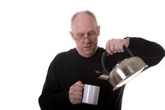 Old Guy Fixing Tea Royalty Free Stock Photo