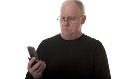 Old Guy in Glasses Looking at Phone Confused Royalty Free Stock Photography