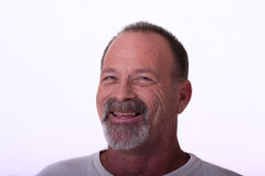 Old Guy with Gray Beard Smiling Stock Images