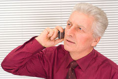 Old guy with phone Stock Photography