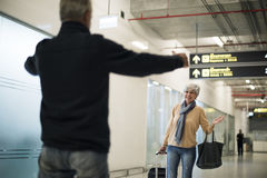 Old guy picking up his woman at the airport stock images