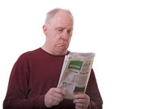 Old Guy Reading Financial Section Royalty Free Stock Photos