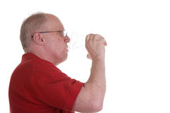 Old Guy in Red Shirt Drinking Water from Glass Stock Images