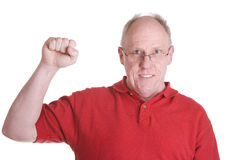 Old Guy in Red Shirt with Fist in Air Stock Photography