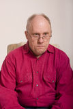 Old Guy in Red Shirt Looking Thoughtful Stock Images