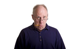 Old Guy Sick with Thermometer in Mouth Royalty Free Stock Images