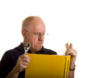 Old Guy With Do It Yourself Book Royalty Free Stock Photography