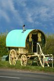 Old gypsy caravan. Old fashioned gypsy caravan parked on side of the road royalty free stock images