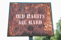 Old habits die hard message. Old habits die hard text message on the board Royalty Free Stock Images