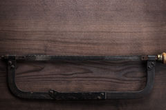 Old hacksaw rusty on wooden background Stock Images