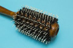 An old hairbrush with dropped hair, hygiene royalty free stock image