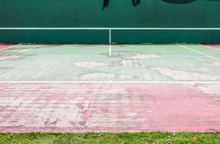 Old half tennis court Stock Images
