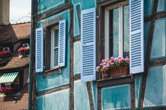 Old half timber fachwerk windows on house in Colmar, France.  Royalty Free Stock Images