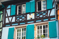Old half timber fachwerk windows on house in Colmar, France.  Royalty Free Stock Photo