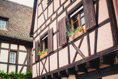 Old half timber fachwerk windows on house in Colmar, France.  Stock Image