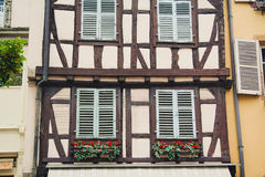 Old half timber fachwerk windows on house in Colmar, France.  Royalty Free Stock Photography