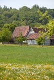 Old half-timbered farm houses with forest and agricultural fields. An old half-timbered farm houses with forest and agricultural fields stock photography