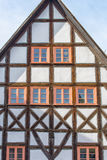 Old half-timbered house with rustic wooden windows Stock Photos
