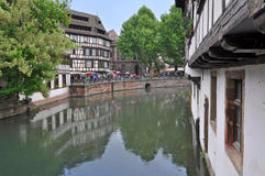 The old half-timbered houses of Strasbourg, reflected in water. Stock Photography