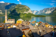 Old Hallstatt village in Alps and lake at dusk, Austria, Europe. Famous Hallstatt village in Alps and lake at beautiful day, old architecture, Austria, European Stock Photography