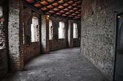 Old hallway and brick wall seen from inside Stock Image