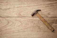 Old hammer. Above Hammer on wood background Stock Image