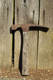 Old Hammer against Aged Fence Stock Images