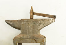Old hammer and anvil tools. Royalty Free Stock Photo