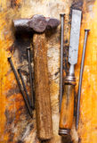 Old hammer and chisel. On wooden background royalty free stock photos