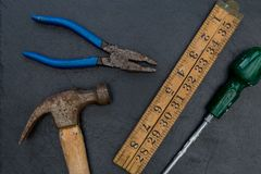 Old hammer and DIY tools on dark background. Old hammer and DIY construction tools on dark background stock photography