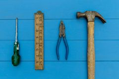 Old hammer and DIY tools on wood background. Old hammer and DIY tools on blue wood background Stock Photos