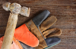 Old Hammer and leather gloves Royalty Free Stock Photography