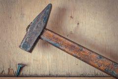 Old hammer and nail royalty free stock photo
