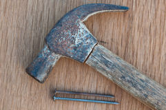 Old hammer with nail Royalty Free Stock Photo