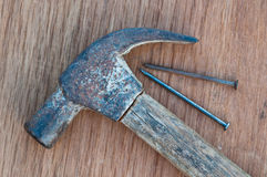 Old hammer with nail Stock Image