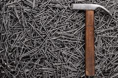 Old hammer and nails on table Royalty Free Stock Images