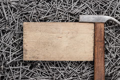 Old hammer nails and wooden board Royalty Free Stock Images