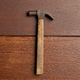 Old hammer. Old rusty hammer with clipping path on wooden floor Royalty Free Stock Photo