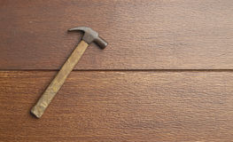 Old hammer. Old rusty hammer with clipping path on wooden floor Stock Image