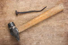 Old hammer and a rusty nail Stock Photos