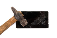 An old hammer and smartphone Royalty Free Stock Images