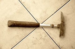 Old hammer on a tiles Stock Images