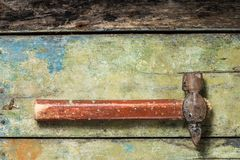 Old hammer on wood background Royalty Free Stock Images