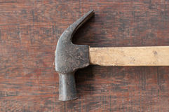 Old hammer on wood board Stock Photo