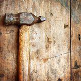 Old hammer on wood Stock Photography